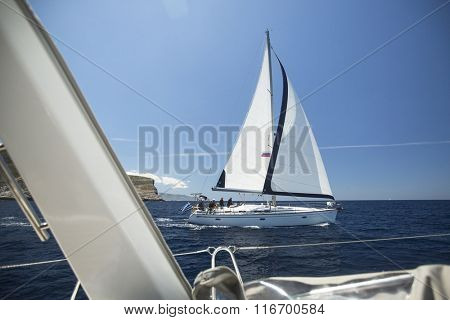 SYROS-KYTHNOS, GREECE - CIRCA MAY, 2014: Sailboats participate in sailing regatta 11th Ellada 2014 among Greek island group in Aegean Sea, in Cyclades and Argo-Saronic Gulf.
