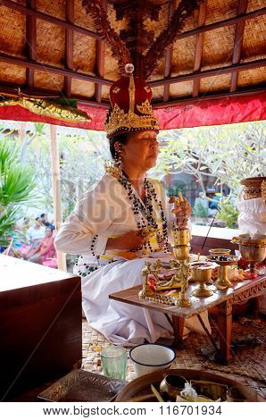 A Balinese-Hindu priestess prays during a baby-naming ceremony in Bali, Indonesia
