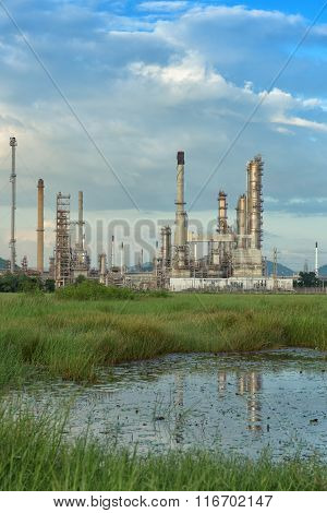 Before Sunset On Blue Sky Background Of The Oil Refinery Plant.