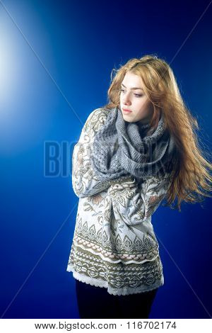 Young woman in jersey on blue background