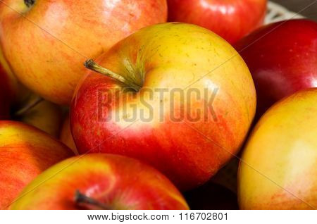 Fresh Apples On A Wooden Table In The Background