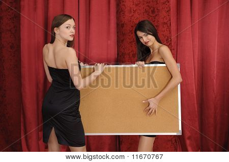Girls Hold Empty Board