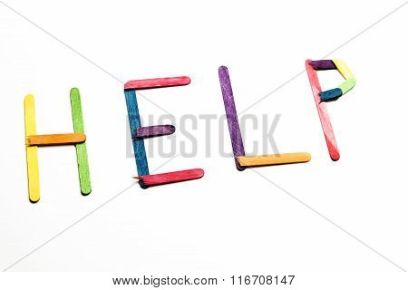 Word Help Spelled Out With Colored Popsicle Sticks