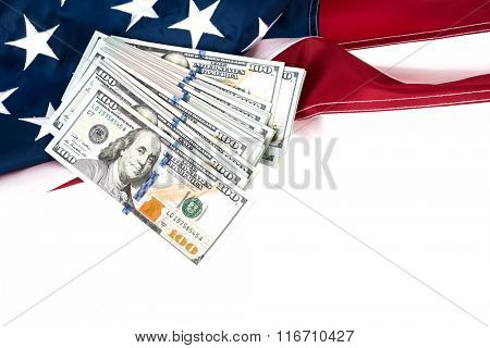 One hundred dollars banknotes on flag background