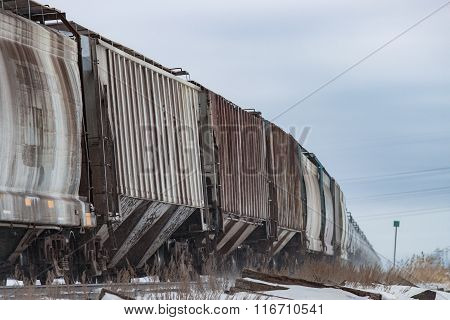 Railway Cars Curving Into The Distance