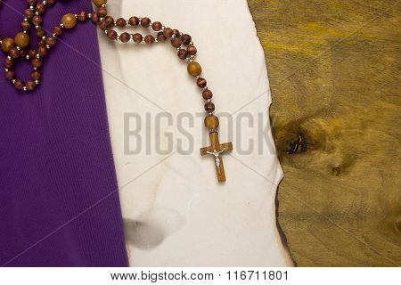 Old Burnt Parchment With A Catholic Cross