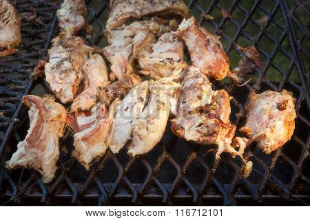 Pork meat grilled in open fire