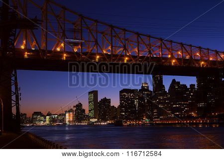 Manhattan and Roosevelt Island bridge at night in New York USA.