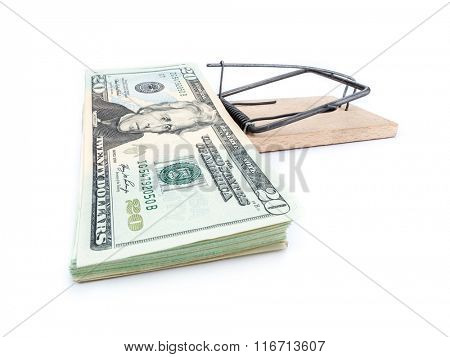 Mouse trap with 20 dollar bill pile attached as bait on whiite background