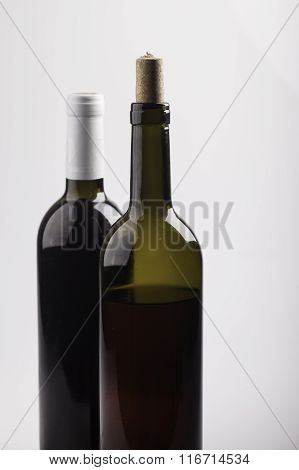 two bottles of wine on white background closeup