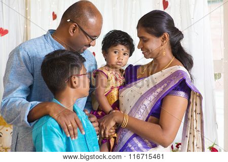 Traditional India family portrait. Indian parents and children in a blessing ceremony.