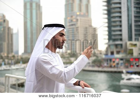 Young Emirati arab man taking selfie
