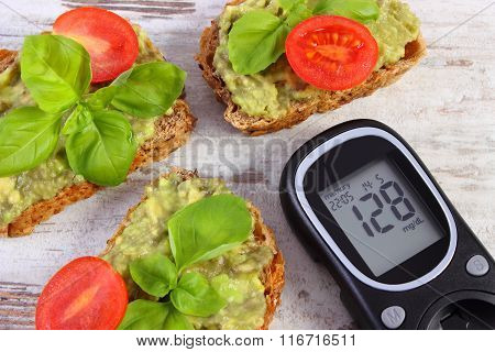 Glucose Meter And Freshly Sandwiches With Paste Of Avocado, Diabetes, Healthy Food And Nutrition