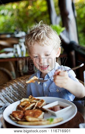 Kid Eating Breakfast