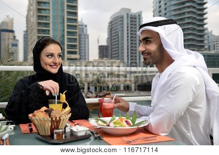 Young Emirati arab couple dining
