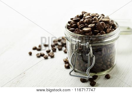 Large glass jar full of coffee beans