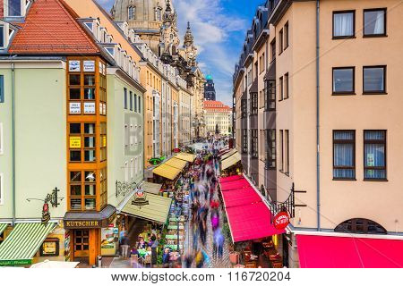 DRESDEN, GERMANY - SEPTEMBER 21, 2013: Pedestrians in the Munzgasse alleyway. The historic cobblestone alley is lined with many of Dresdens most famous restaurants and cafes.