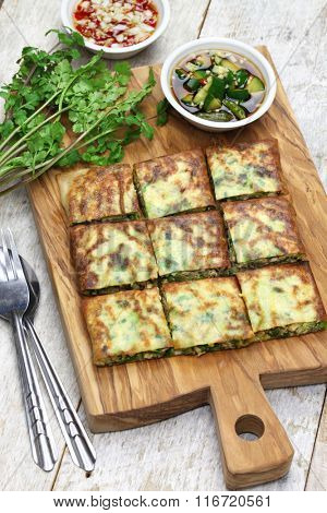 homemade martabak telur, indonesian street food. fried wrap filled with eggs,minced meat, and vegetables.