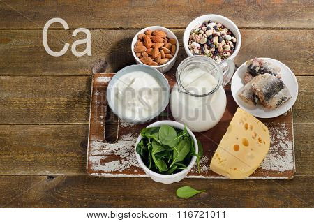 Foods Highest In Calcium On Rustic Wooden Board.
