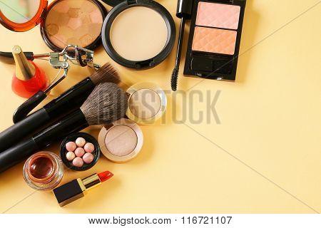 cosmetics set for make-up (face powder, lipstick, mascara brush, nail polish, blush, eye shadow)