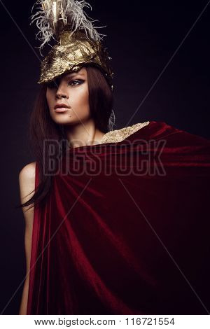 Woman in head wear with feathers