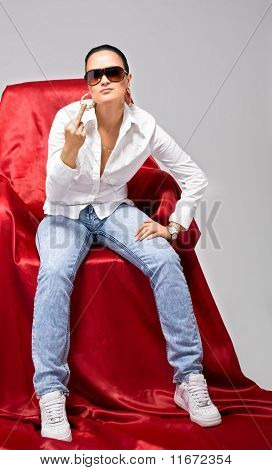 Young tomboy sit on chair