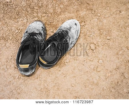 Dirty Shoes Sneaker On Ground Surface
