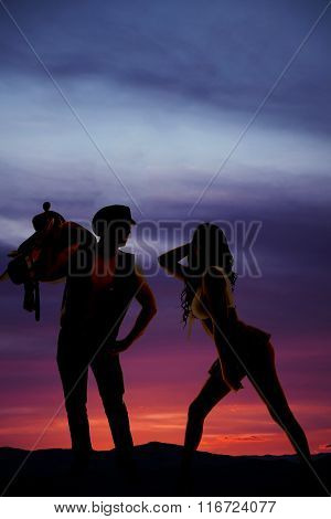 Silhouette Of Woman In Short Skirt Side Butt Out Cowboy