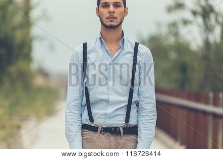 Young Handsome Man Posing In An Urban Context