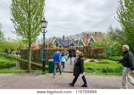 Zaanse Schans, Netherlands - May 5, 2015: Tourists Visit Windmills And Rural Houses In Zaanse Schans