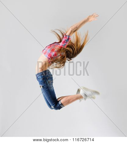 Modern dancer girl on grey