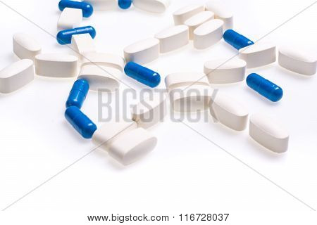 White and blue medical pills for treating diseases on a white background