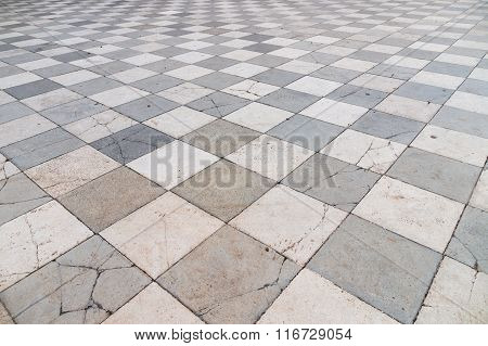 Old And Partly Cracked Tiled Floor