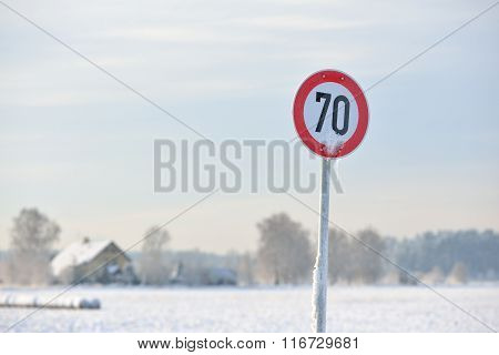 Frozen Road Speed Control Sign In Winter With Copy Space