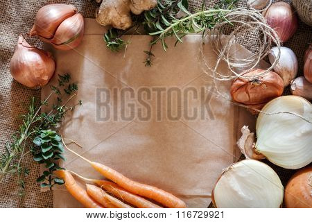 Rustic food background with brown paper and hessian.  Room for text.