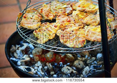 Grilled meat cooking on a barbecue close-up