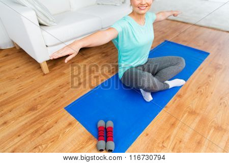 close up of woman exercising on mat at home