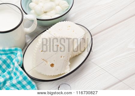 Dairy products on wooden table. Milk, cheese and curd. Top view with copy space