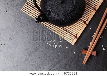 Asian teapot over stone table. Top view with copy space