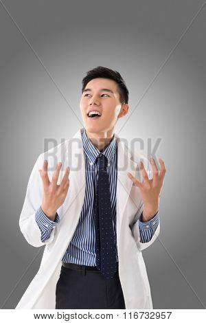 crazy Asian doctor, closeup portrait.