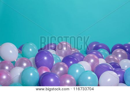 turquoise background with balloons