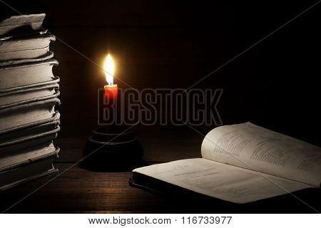 Old Shabby Books, Lighted Candle, Open Book On Wood  Background