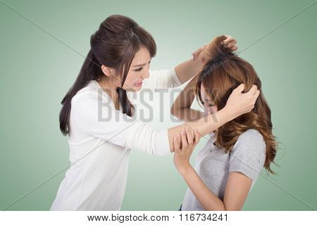 Asian women fight and pull hair.