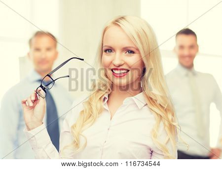 smiling businesswoman or secretary in office