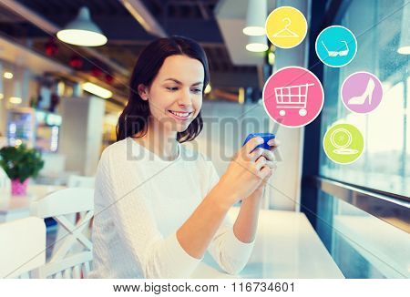 smiling woman with smartphone shopping online