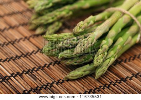 Ripe Green Mini Asparagus On Wooden Mat