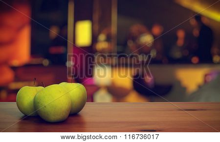 green apples on table in a night club