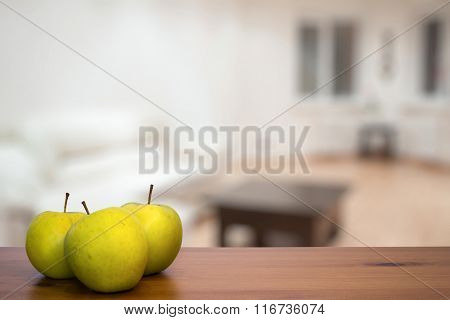 green apples on wooden table in the living room