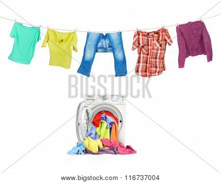 A Close Up Of A Washing Machine Loaded With Clothes And Clothes On The Ropes Isolated On White Backg