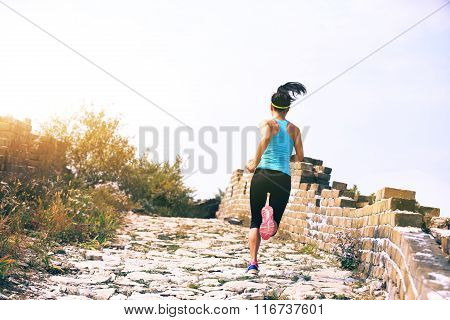 young fitness woman runner running on chinese great wall